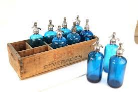vintage seltzer bottles in blue glass