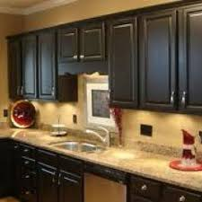 black cabinets and tan walls this is