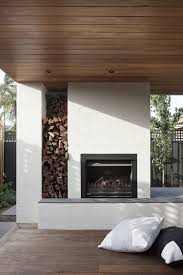 wood stack by outdoor fireplace