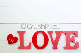 word love wooden text and heart shape