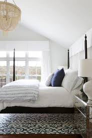white and blue rug under queen bed