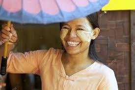 myanmar woman wearing thanaka makeup
