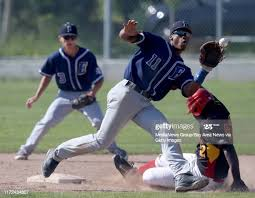 Berkeley's Michael Dixon safely steals second base against Encinal's...  News Photo - Getty Images