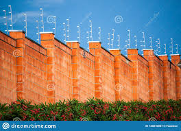 Security Electric Fence And Red Brick Wall In A Residential Gated Community Stock Image Image Of Home Community 144810007