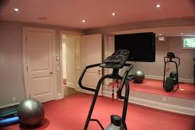 home gym tv mounted on mirror wall