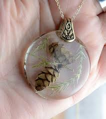 pine cones in resin necklace set in