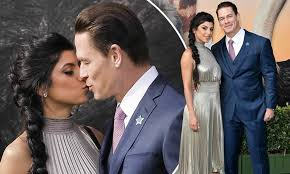 john cena packs on the pda with hew new