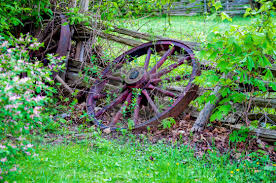 Old Wagon Wheel Against A Wooden Fence License Download Or Print For 24 80 Photos Picfair