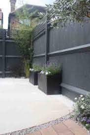 Fence Painted In Farrow And Ball Downpipe Works Beautifully As A Backdrop To Greenery And Lavender Backyard Fences Backyard Fence Paint
