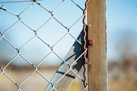 Closeup Photography Of Nail Stumped On Wood Beside Wire Link Fence Photo Free Image On Unsplash