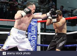 Barry Morrison (white shorts) defeats Billy Smith in a Light ...