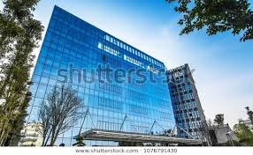 modern glass office building blue sky