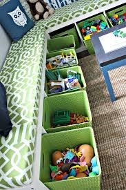 Kids Play Room Idea Love This Bench With Storage Idea And To Have It Wrap Around The Room They Used Bookshelves On Their Playroom Toy Rooms Kids Playroom