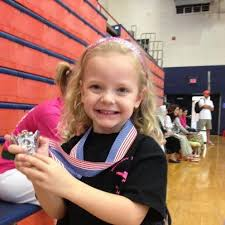 Addie Miller won a medal in the Lil' Dragons competition at Spar ...