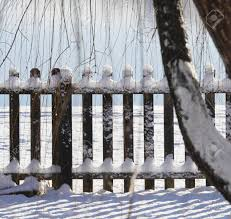 Wooden Fence With The Tops And Bottoms Covered With Fresh Snow Stock Photo Picture And Royalty Free Image Image 134950276