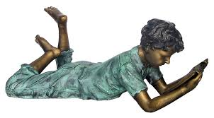 boy reading book garden statue