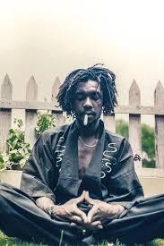 Peter Tosh in Meditation Burning Spliff Photograph by Fikisha Cumbo