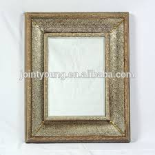 large wooden vintage wall mirror
