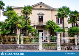 Abandoned Two Floors Classical Italian House With Growing Palm In The Garden Metal Fence And Gate At The Entrance In Riva Del Stock Image Image Of Gate City 167821757