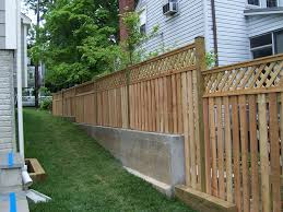 Wood Semi Private Fence Alternating Board With Lattice Topper On Retaining Wall Fence Design Wood Fence Design Backyard Fences