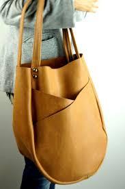 tan leather handbag with exterior
