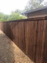 Dark Stained Japanese Cedar Fence With A Elliott Roof And Fence Facebook
