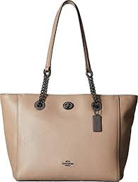 coach pebbled leather turnlock chain