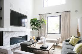 marble fireplace mantle under tv niche