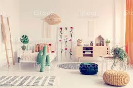Boho Kids Bedroom With White Metal Bed Wooden Furniture And Colorful Poufs Real Photo Stock Photo Download Image Now Istock