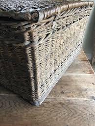 large antique lidded wicker basket for