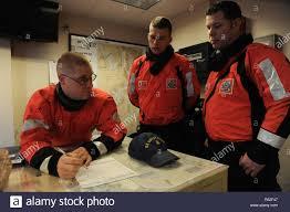 Coast Guard Chief Petty Officer Adam Nichols, Coast Guard Chief Petty  Officer Adrien Cheval and Petty