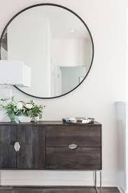 large round black frame mirror mounted