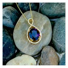 gold jewelry amethyst oval halo pendant