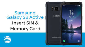 insert and remove a sim or memory card