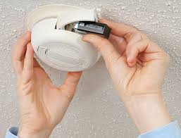 Image result for checking batteries in smoke detectors