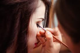 work make up artist doing eye makeup