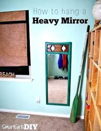 hang a mirror on a wall without nails
