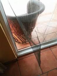 broken sliding screen door on balcony