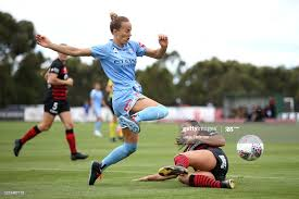 Aivi Luik of Melbourne City is challenged by Sam Staab of Western... News  Photo - Getty Images