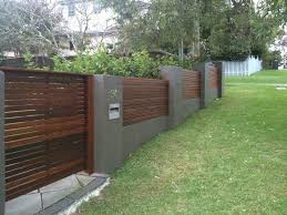 Brick Horizontal Timber Fence On Sloping Ground Modern Front Yard Fence Design Yard Remodel