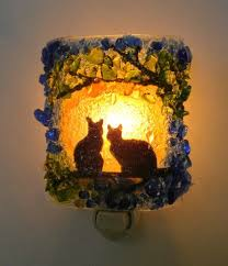 two cats in a tree night nightlights