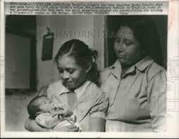1957 Press Photo Hilda Trujillo holds daughter while grandmother watches,  Peru | eBay