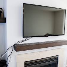 hiding tv wires over fireplace