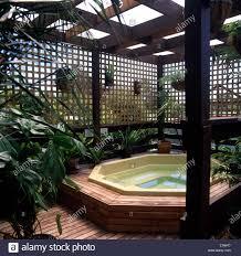Trellis Fence Providing Privacy Around A Jacuzzi In A Town Garden Stock Photo Alamy