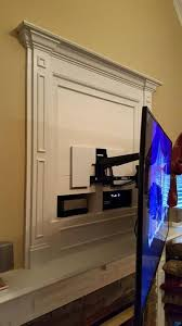make that outdated hole above fireplace