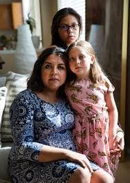 Adriana May-Azuero, from left, and her children Jaise May, 7, and Sophia  May, 11, behind, at th …   Las Vegas Review-Journal