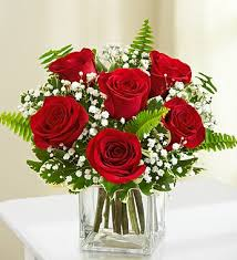 6 red roses in a cube vase in