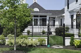 Crisp Black Wrought Iron Fence With White Brick Base Wrought Iron Fences Iron Fence Curb Appeal