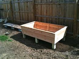 a classic raised garden planter box