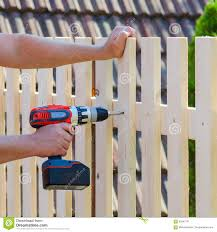 Man Hands Building Wooden Fence With A Drill And Screw Diy Concept Close Up Of His Hand And Tool Stock Image Image Of Maintenance Activity 99247141